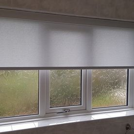 Roller blinds installed in a bathroom for extra privacy