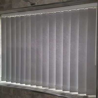 perfectly installed vertical blinds in a bathroom