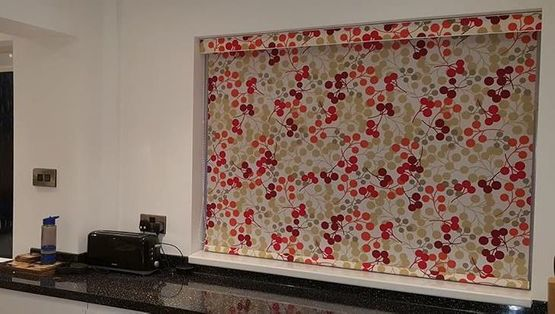 Colour full roller blinds installed in a kitchen