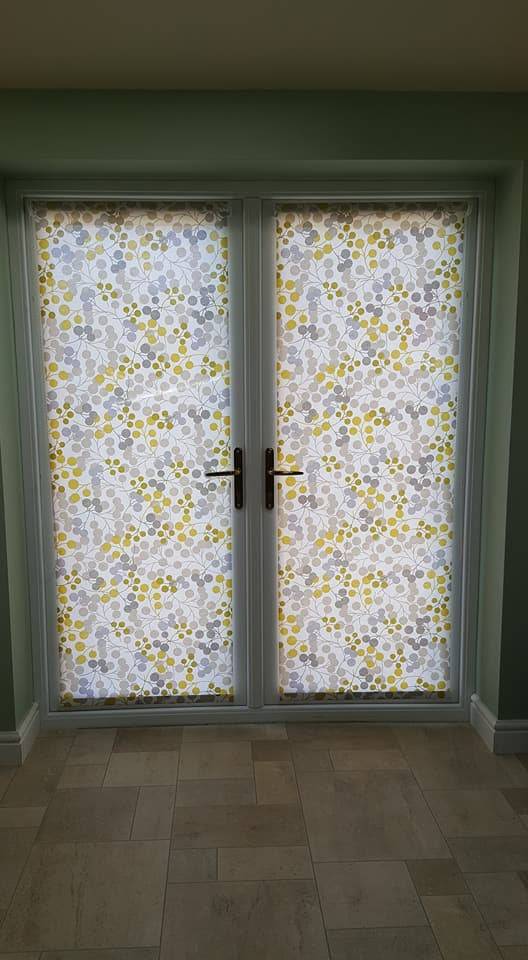 Roller blinds made to fit over double doors