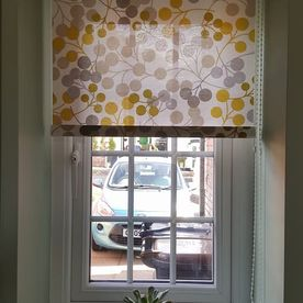 Dotted roller blinds installed in a home