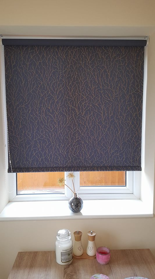 Plain styled roller blinds installed in a room to add a touch of colour