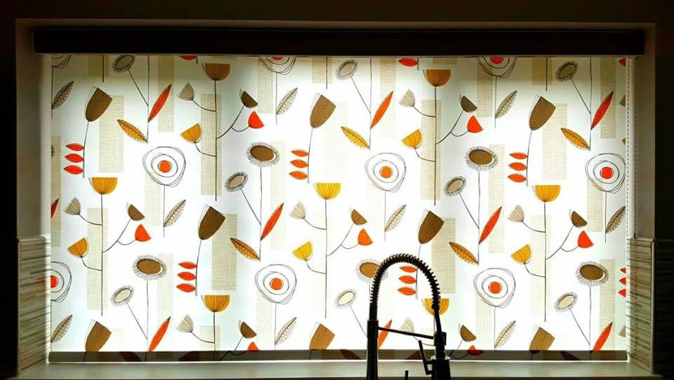 Roller blinds blocking out light in a kitchen